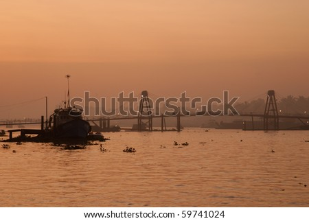 Bridge over Mekong river at sunrise - stock photo