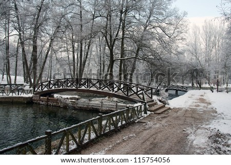 Bridge over river in winter season - stock photo