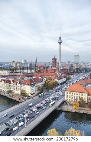 Bridge over river Spree, TV-tower and Rotes Rathaus (Red City Hall) in Berlin, Germany - stock photo