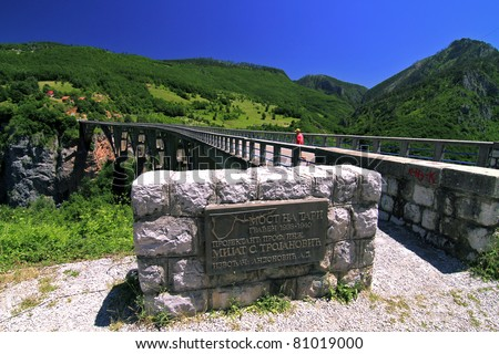 Bridge over Tara river with a small monument near by - stock photo