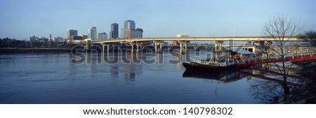 Bridge over the Arkansas river and Little Rock skyline in Arkansas, USA - stock photo