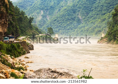 Bridge over the ganges river in india after heavy rain. - stock photo