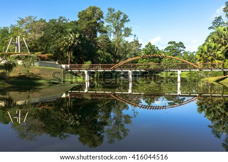 Bridge over the lake with reflection at Labuan Botanical Garden,Labuan,Malaysia.  - stock photo