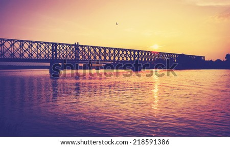 Bridge over the river and beautiful sunset, retro style