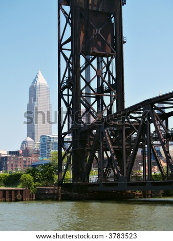 Bridge over the water with a view of downtown Cleveland, Ohio in the background - stock photo