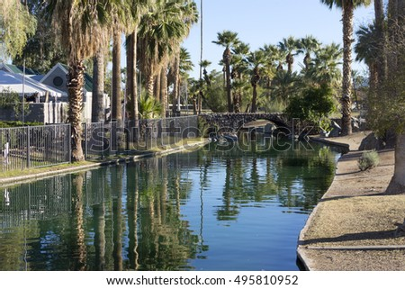 Bridge over water leading to a popular family holiday destination in Phoenix downtown Enchanted Island.