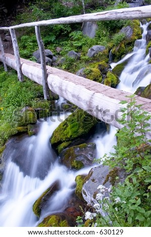 Bridge over waterfall, Mount Rainier National Park - stock photo