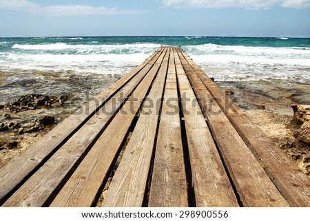 bridge pier on the beach - stock photo