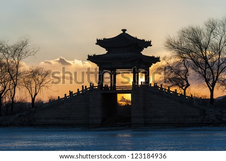 Bridge silhouette under the sunset in Summer Palace