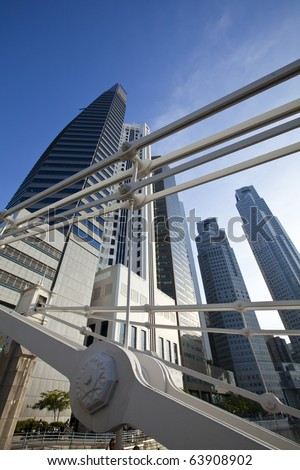 Bridge structure in front of Singapore Skyline on a sunny day. - stock photo