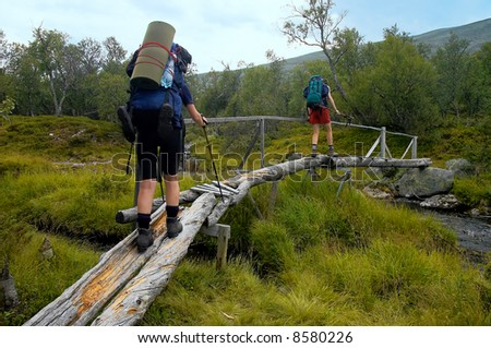 bridge trekking outdoor woman girl nature adventure - stock photo