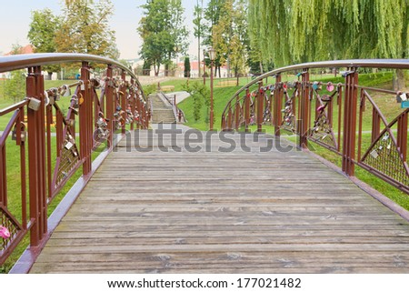Bridge with an old padlocks in park. Grodno, Belarus - stock photo