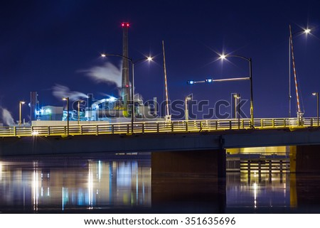 Bridge with factory in background - stock photo