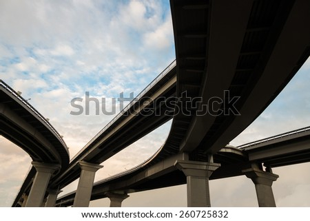 Bridge with highway interchange, view from below - stock photo