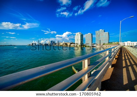 Bridge with skyscrapers in the background, MacArthur Causeway Bridge, Miami, Florida, USA - stock photo