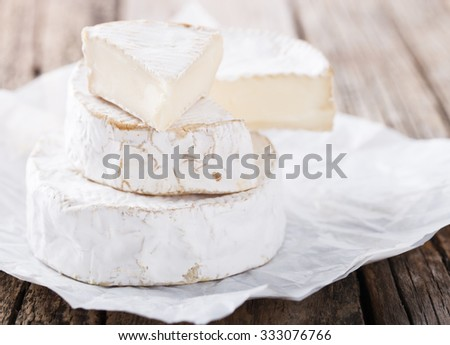 Brie cheese on a wooden Board.selective focus. - stock photo