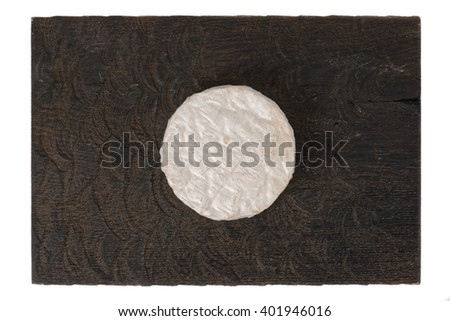 Brie cheese on black wooden board, isolated on white - stock photo