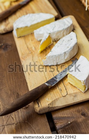 Brie cheese on wooden slate - stock photo