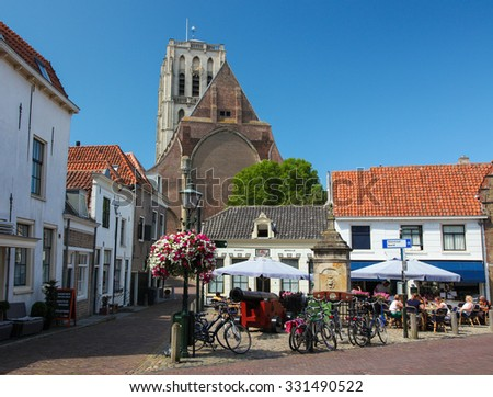 BRIELLE, THE NETHERLANDS - AUGUST 8, 2015: Church of Saint Catherine and Old Houses in Brielle, also known as Den Briel, in South Holland, The Netherlands - stock photo