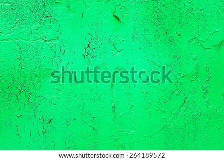 Bright abstract background old metal surface sloppy paint green paint with highlights, streaks, scratches and cracks - stock photo