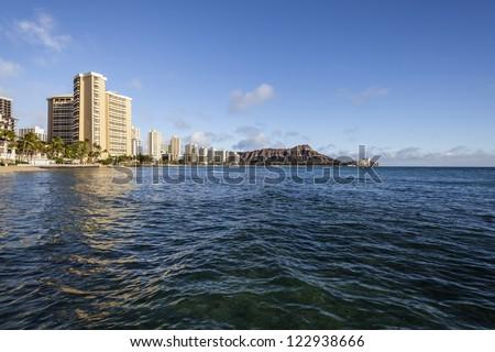 Bright afternoon light on Hawaii's Wakiki resorts in Honolulu. - stock photo