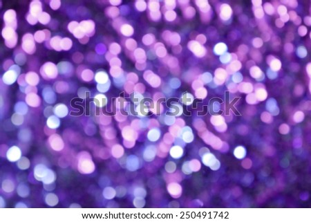 Bright and abstract blurred blue background with shimmering glitter - stock photo