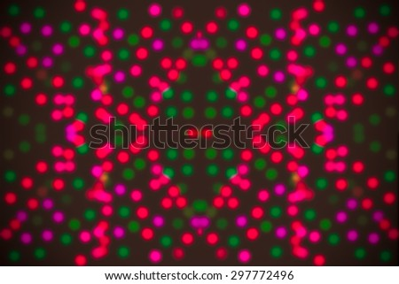 Bright and abstract blurred green and red background with shimmering glitter - stock photo