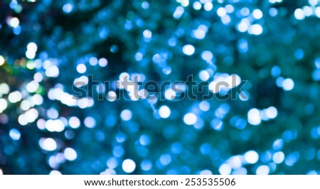 Bright and abstract blurred sea blue background with shimmering glitter - stock photo