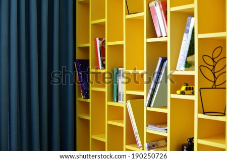 bright and beautiful book shelf in children room - stock photo