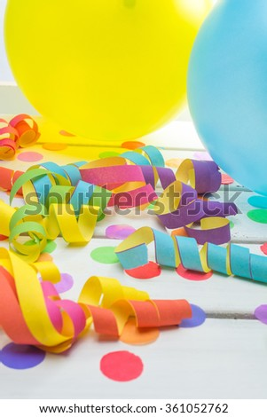 Bright and Colorful Party Background with Confetti Streamers and Balloons