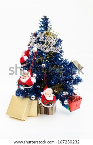 Bright and colorful studio shot of a Christmas tree with gift boxes