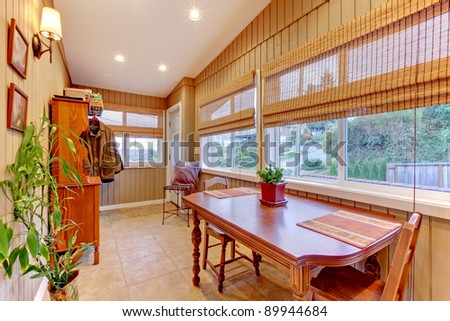 Bright and cozy breakfast room with many windows.