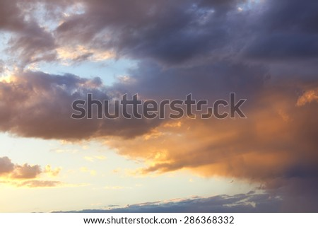Bright and dark clouds looks like enigmatic figures in sky - stock photo