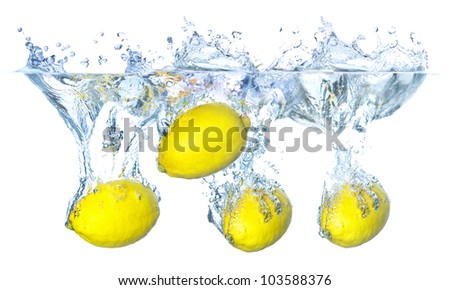 Bright and juicy yellow lemons under water. Fresh and healthy meal