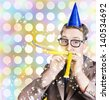 Bright and vibrant photograph of a nerd man in glittering party hat celebrating a birthday bash with a puff of noise and bubbles. Fun times - stock photo