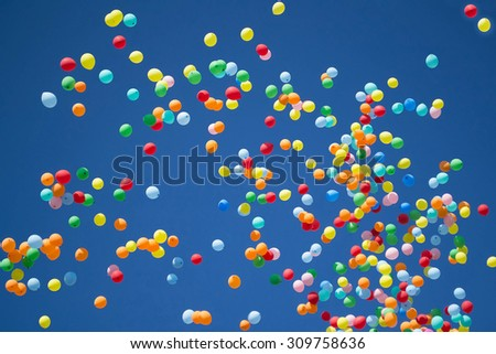 Bright background: a lot of colorful balloons in the sky during the celebration - stock photo