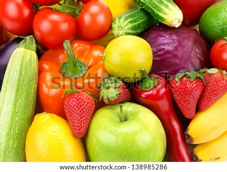 bright background of different fruits and vegetables - stock photo