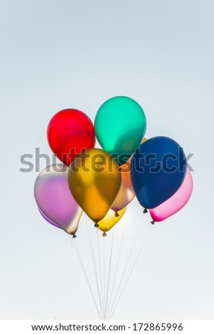 bright balloons isolated on sky - stock photo
