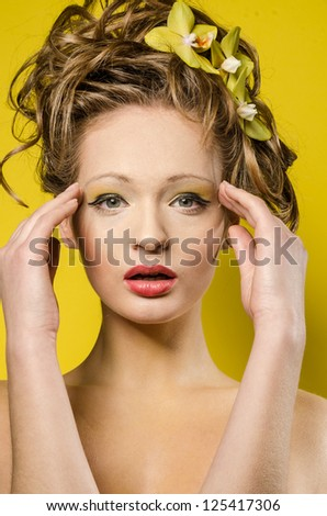 Bright beauty portrait over yellow background