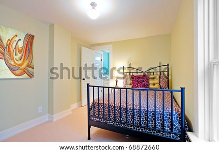 Bright bedrooms with nice beds and art. Light green walls.