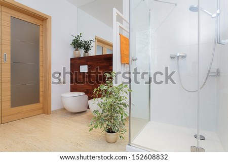 Bright big bathroom with beautiful green plants - stock photo