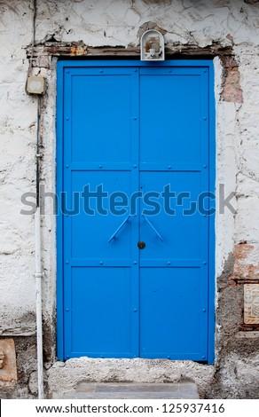 Bright blue door on old building in Turkey - stock photo