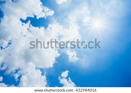 Bright blue sky and white clouds, the sun shines in the sky. Summer heavens cloudy outdoor wallpaper. - stock photo