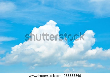 Bright blue sky & clouds as background - stock photo