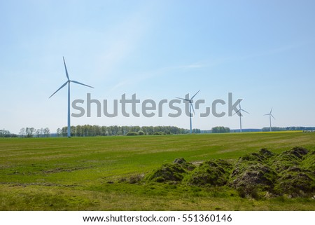 Bright blue sky moving and wind turbine.