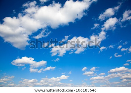 bright blue sky with light clouds