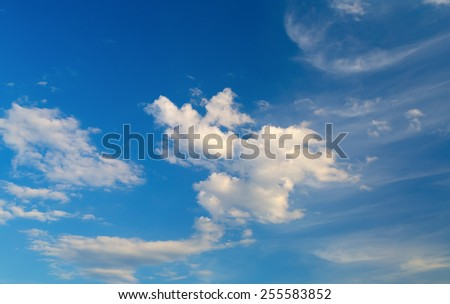 Bright blue sky with white clouds on a clear sunny day. - stock photo