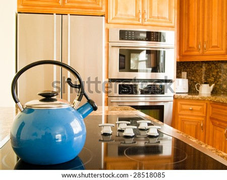 Bright Blue Traditional Whistling Kettle in Modern American Kitchen. - stock photo