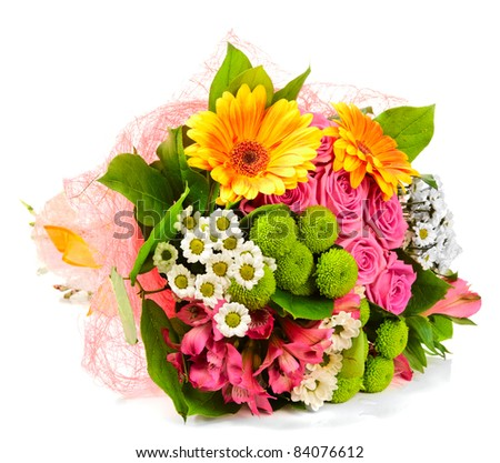 Bright bouquet lying on a white surface - stock photo