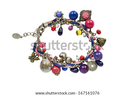 Bright bracelet with different beads on white background - stock photo